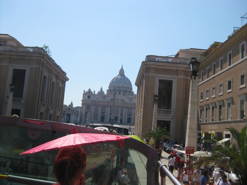 Touring Rome from atop a double decker bus